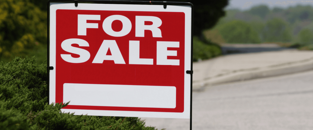 till salu tecken för fastighetsfastigheter hus